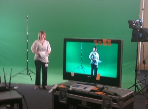 Leannne standing on the green screen.